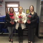 TCAFCU Donates Poinsettia Plants to Meals on Wheels Recipients