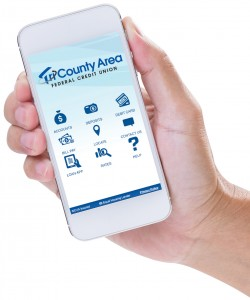 hand holding cellphone showing TCAFCU mobile app