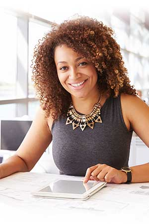 smiling business woman using tablet