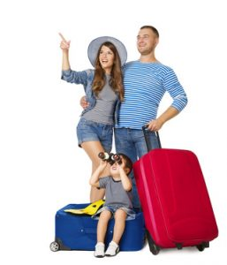 Young Family Traveling with Suitcases. Child sitting on Luggage with Binoculars Looking up.