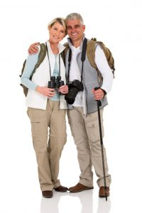 lovely senior hiking couple hugging